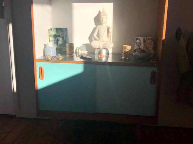 'The sun lighting the Buddha on my shrine this morning' David N